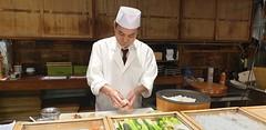 Sushi chef at Tsukiji Itadori Bekkan - Tokyo Japan 2020