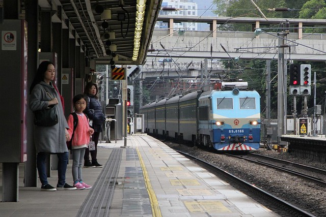 China Railways electric locomotive SS8 0166 leads a rake of 25T carriages northbound Through Train through Sha Tin station