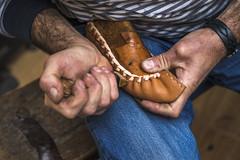 Shoemaker embellish a traditional shoe