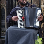 Joyful Accordian Busker by Ken Busbridge