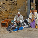 Morroccan Street Cobbler and Customer by Carl Kurstein