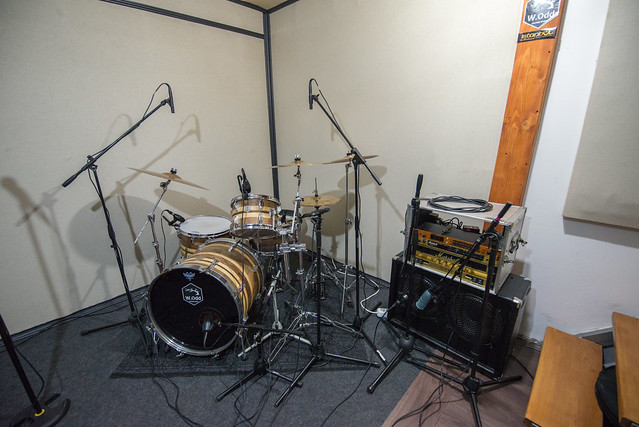 Photo:Homemade music studio. Drums and guitar amp in the corner By shixart1985