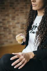 A young woman enjoying her coffee break