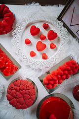 Valentine cake and cookies decoration in red colors