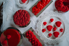 Valentine cake and cookies decoration in red colors. Top view