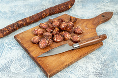 Fresh homemade Sausage sliced on the wooden board