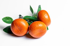 Orange tangerines with green leaves fridge magnets