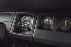 A close-up of an analogue dashboard on a vintage car