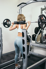 Young blonde woman working out in the gym