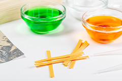 Chemical solutions and indicator paper. Analysis concept
