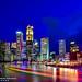 SINGAPORE SKYSCRAPERS RAFFLES PLACE IN BLUE HOUR NIGHTSHOT