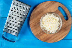 Grated Cheese on the wooden kitchen board
