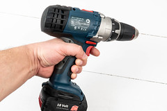 Accu Drill in the hand above white background