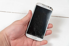 Time For Upgrade concept with old broken Samsung mobile phone
