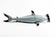 Grey hammerhead shark toy on white background