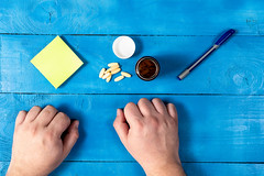 Health Concept with Pills on the table hands and copy space
