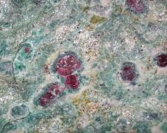 Rubies encased in K-feldspar in fuchsite-rich matrix (Precambrian, eastern Brazil) 4