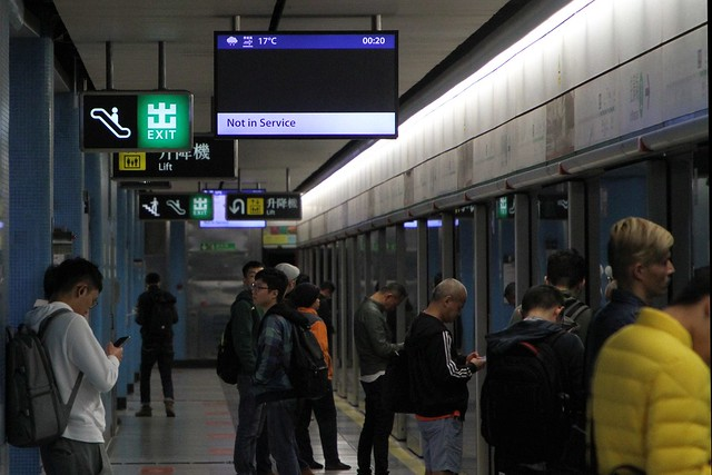 'Not in service' message at Kowloon Tong - a push-pull battery electric locomotive hauled works train passing through