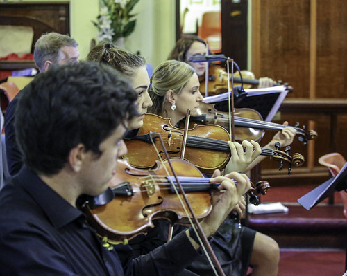 Ipswich City Orchestra string section.