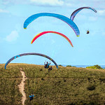 Paragliding at the downs by Derek Dewey-Leader