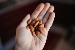Hand full of almonds closeup