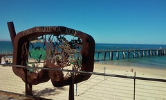 Port Noarlunga jetty or pier and the Port Noarlunga Reef rusty sculpture.