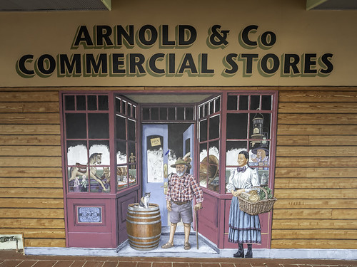 Urunga NSW - Mural shows 3 shop fronts with local people and it's 3 dimensional. Artist is a local resident Mr David Bromley