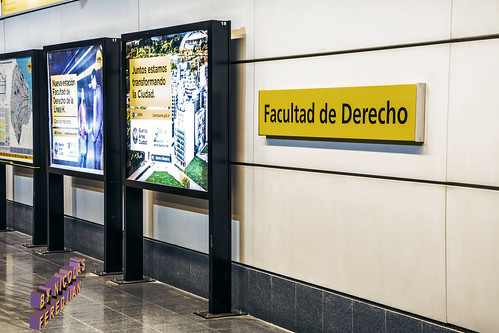 Signage of the station mounted on the platform wall