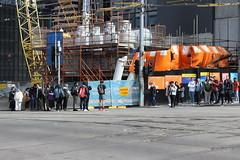People waiting to cross La Trobe Street at Swanston Street, Melbourne