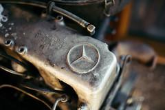Mercedes logo on old car engine.