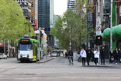 People, tram and bike on Swanston Street, Melbourne