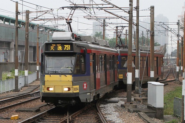 Coupled Phase II LRV 1084 and 1204 on route 751 arrives at Siu Hong stop