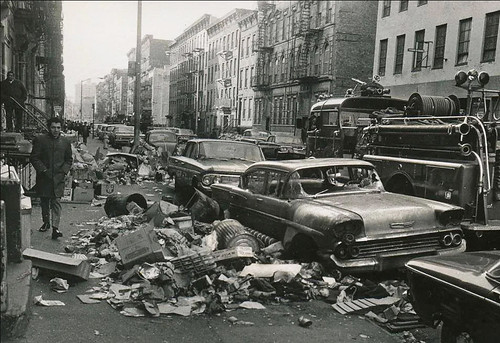 Welcome to the good old days in New York! An abandoned and vandalized 1958 Chevy Bel Air  parked among ever growing piles of uncollected trash.  Sorry, no Starbucks or Thai restaurants here. February 1968