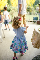 Children birthday outdoor party. Happy little girl in glamour dress.