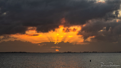 Sunrise hidden sun and sun rays
