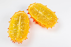 Top view, halves of kiwano fruit on a white background