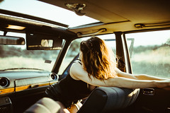 Young woman relaxing in a car during a trip,