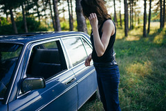 The hipster woman drives the car into the forest and can't find the solution