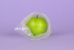 Green apple packed in bubble wrap