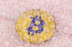 Bitcoin covered with bubble wrap
