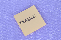 Fragile label laying on bubble wrap