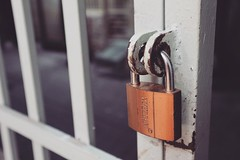 closeup-photography-of-white-gate-with-brass-colored-padlock-846288
