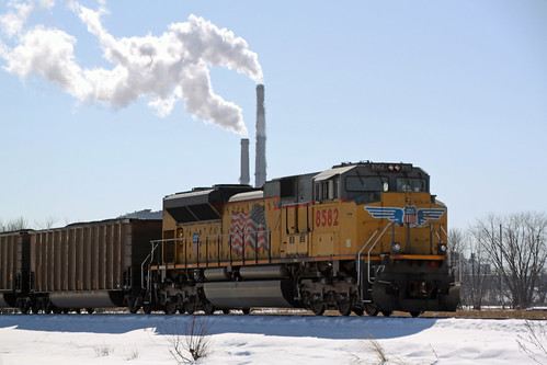An EMD DPU on the coal loads with its destination in the background