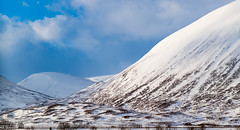 Plenty drifting snow on the Mountains of The Pass of Drumochter .