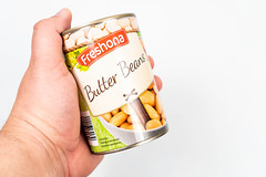 Canned White Beans in the hand above white background