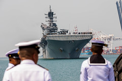 Royal Thai Navy seamen observe the USS America (LHA 6) during a welcoming ceremony, Feb. 22, 2020, at Laem Chabang, Thailand.