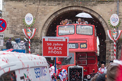 The float celebrating the 50th anniversary of one of the most successful music bands connected to Carnival in Cologne, Bläck Fööss, is a red double-decker bus