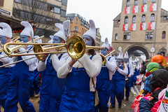 Brass band from South German region Allgäu marches in The Smurfs costumes in front of the Severinstorburg at the Rose Monday parade during the Cologne Carnival