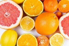 Set of different citrus fruits on a white background, top view
