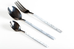 Spoon, fork and teaspoon on white background